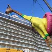 Anthem of the Seas' newest resident - a giraffe wearing a swimsuit and buoy. Photo credit: Royal Caribbean